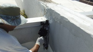 Application of roofing cement